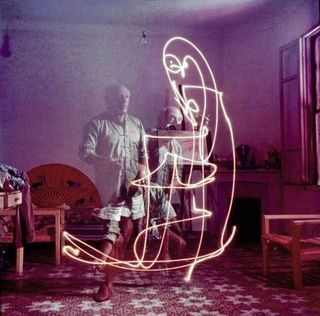 Gjon Mili - Triple Exposure of Picasso Drawing with Light - 1949