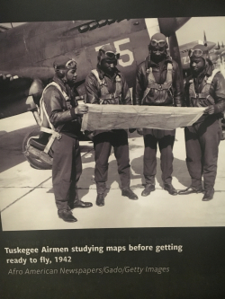 Tuskegee Airmen studying map